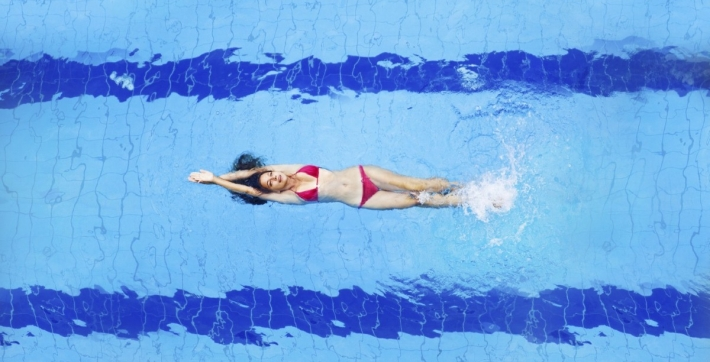 Lady swimming in pool