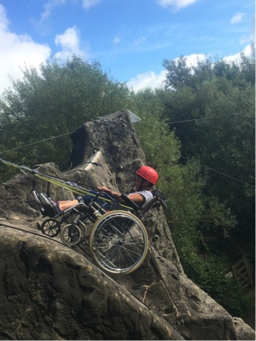 Steph abseiling in a wheelchair