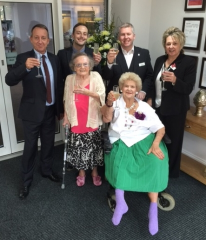 First residents and staff raise a toast