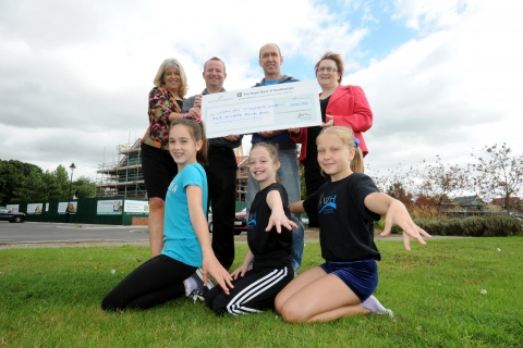 gymnasts and presentation cheque