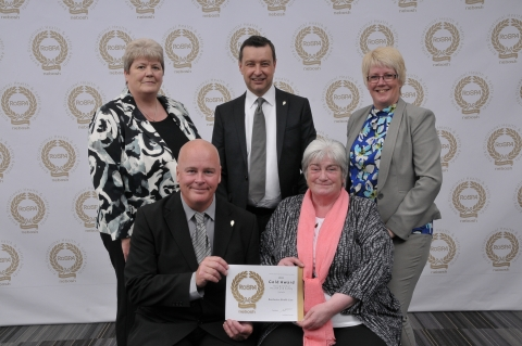 health and safety team with award