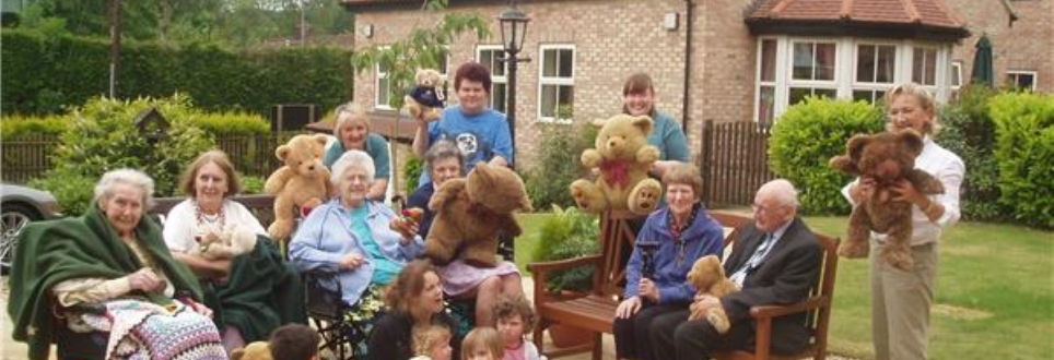 Care home residents and furry friends enjoy a picnic