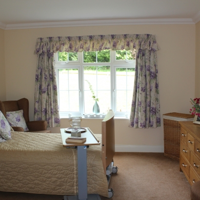 Single room with chest of drawers at the end of the bed