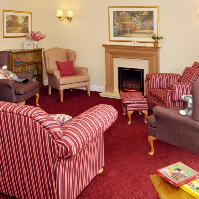 A small living room with sofas and armchairs
