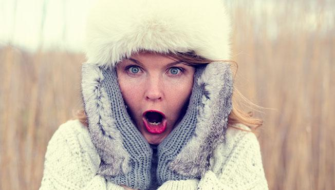 Woman in shock wearing hat and gloves