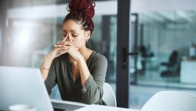 woman in a office looking stressed