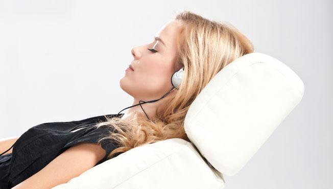 Lady relaxing listening to music.