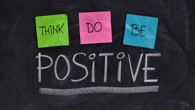 Blackboard with the words think,do, be and positive.