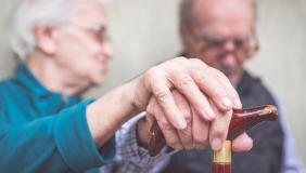 Coping with dementia caring - Older couple holding hands