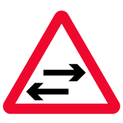 two way traffic crosses a one-way road traffic sign