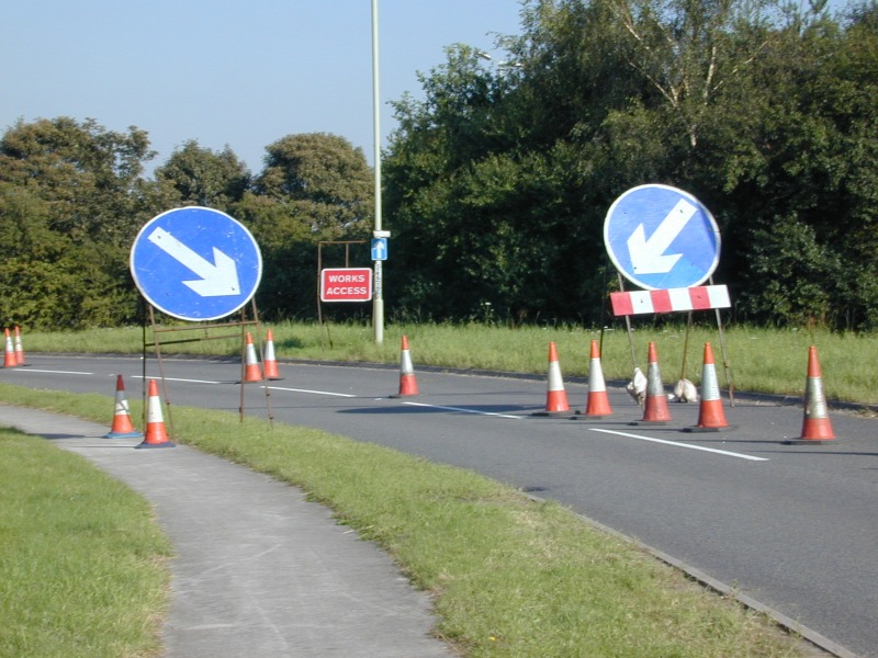 coned off lanes on road