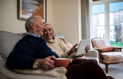 Elderly couple Using iPad Tablet Computer