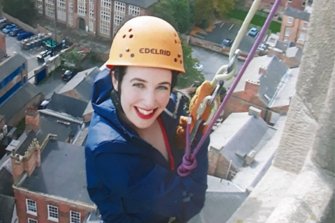 A smiling abseil at the Rainbows Hospice for Children and Young People Derby Cathedral abseil