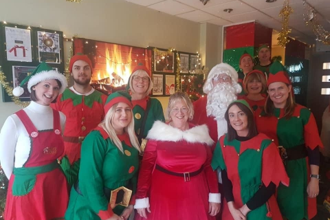 A group of Elves and Santa