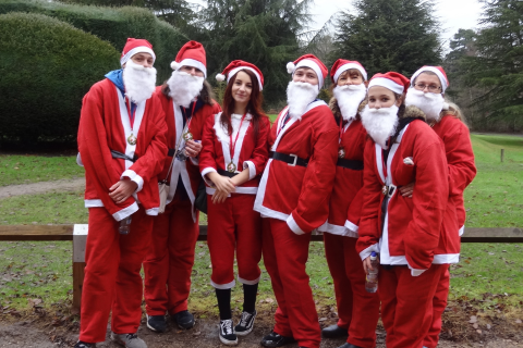 A group of Santa's standing in a semicircle