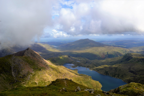 A scenic view of snowdon, with clouds in the sky