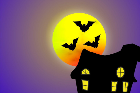 A haunted house with the moon in the background