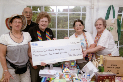 A group of ladies with a large cheque