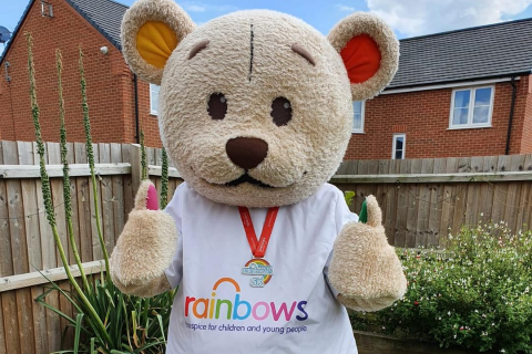 Bow Bear promoting the Corporate Summer Virtual Rainbows 5K for Rainbows Hospice for Children and Young People
