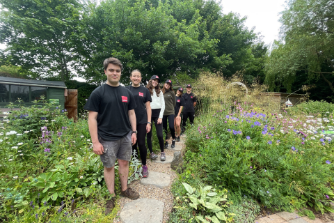 A group of people standing in a garden