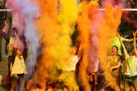 Young people throwing powdered paint in the air