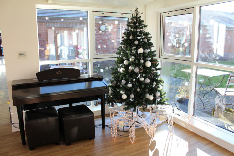 A Christmas tree and piano at Rainbows Hospice for Children and Young People