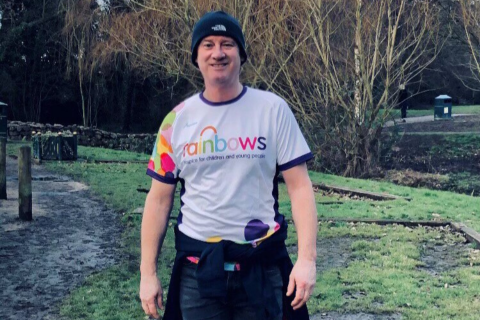 A male supporter in a hat and Rainbows tshirt