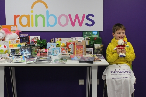 Young Ben gives gifts to Rainbows Hospice