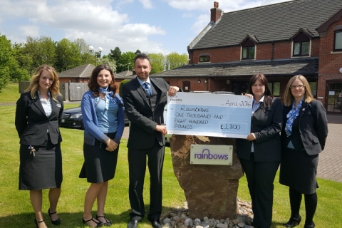 Cheque presentation outside at Rainbows Hospice